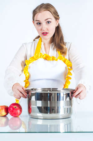 homemaker: Photo of surprised homemaker with pan on white background Stock Photo
