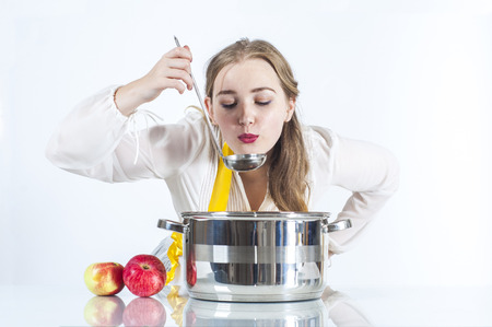 homemaker: Photo of homemaker with ladle on white background