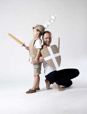 warder: photo of the boy in medieval knight costume made of cardboards with his mother