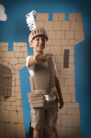 cavalier: photo of the boy in medieval knight costume made of cardboards