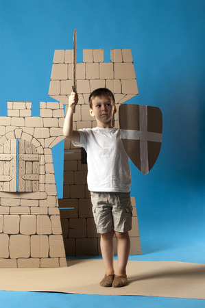 belfry: photo of the child on the medieval  castle decorations background made of cardboards