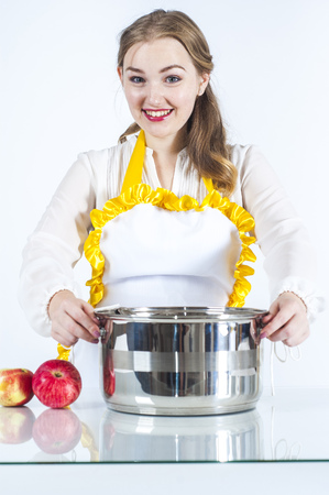 homemaker: Photo of smiling homemaker with pan on white background
