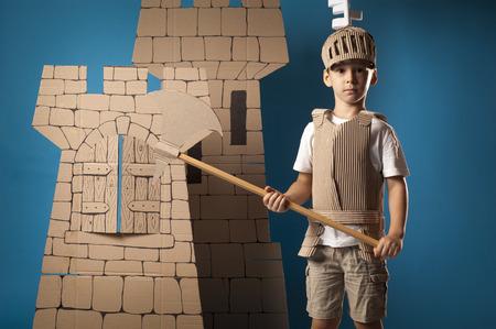 photo of the boy in medieval knight costume made of cardboards Zdjęcie Seryjne - 36437884