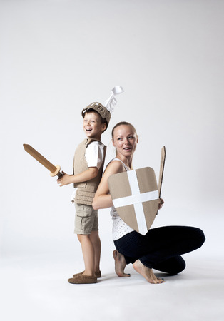 cartoon knight: photo of the boy in medieval knight costume made of cardboards with his mother