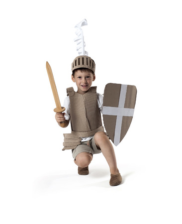 cartoon knight: photo of the boy in medieval knight costume made of cardboards