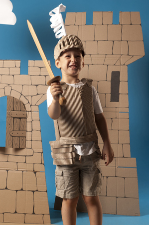 belfry: photo of the boy in medieval knight costume made of cardboards
