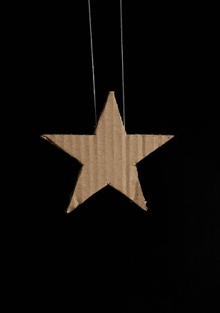 hand made: Hand made cardboard star on black background.