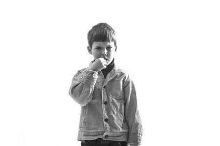 Portrait of Caucasian caprice child on white background. photo