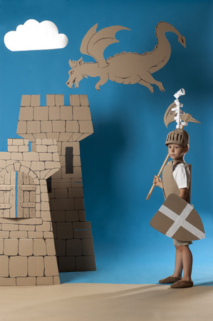 berserk: photo of the boy in medieval knight costume made of cardboards