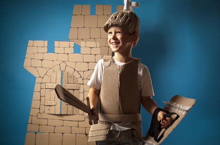 cardboards: photo of the boy in medieval knight costume made of cardboards