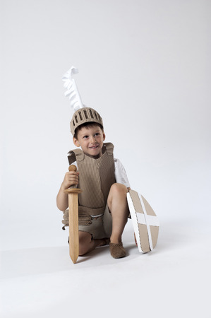 casque: photo of the boy in medieval knight costume made of cardboards