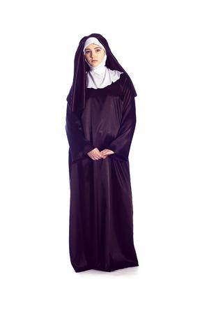 religious habit: Full growth photo of catholic nun on white background.