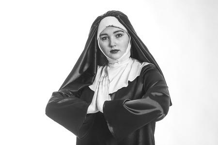 black nun: Young nun prays. Photo on white background. Black and white photo.