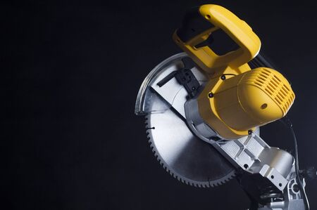 miter: Compound miter power saw isolated on a black background. Stock Photo