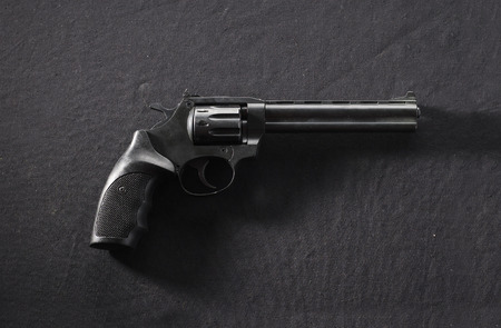pellet gun: Photo of  black revolver isolated on black background Stock Photo