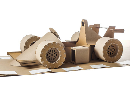 cockpit: Photo of cardboard racing car on white background