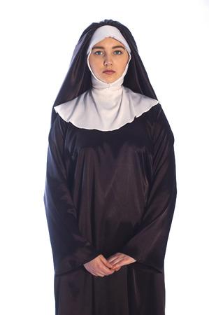 religious habit: Photo of young catholic nun on white background.