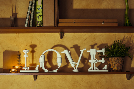 Diy Love Word Made Of Paper Standing On A Bookshelf Stock Photo