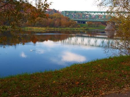 Old green railway bridge across the river