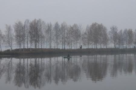 boatman: Photo with foggy island  in autumn.