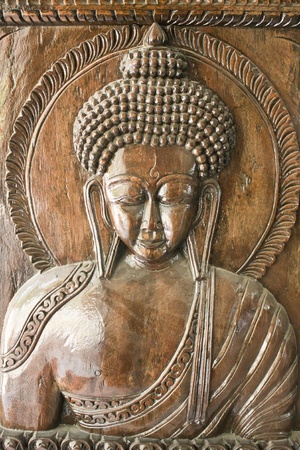 Wooden sculpture with Buddha Stock Photo - 13778218