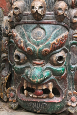 Old wooden religious mask photo