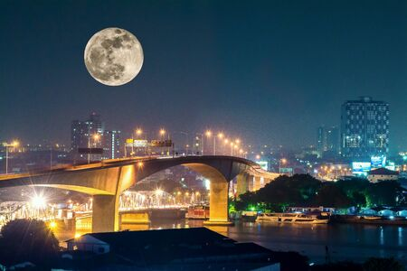 background: The beautiful moonlight in the city Stock Photo