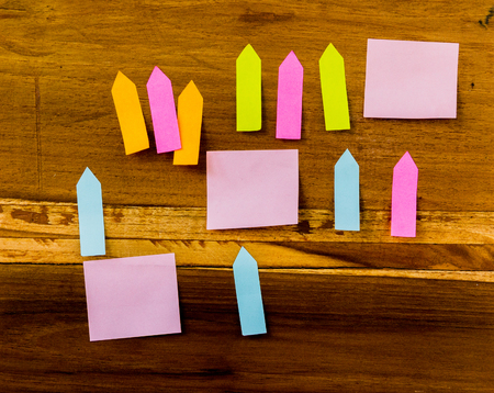 Post it is on the wood. Focus a post it in the  image. Stock Photo