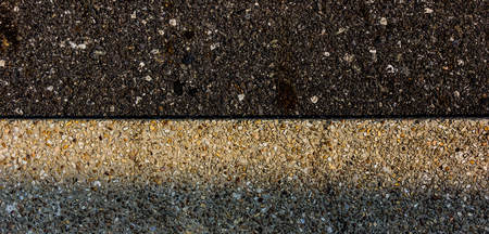 demarcation: The difference in the surface.A shadow in the shade Line of demarcation between the curb and the road surface.