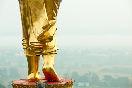 veneration: Walking Buddha statue at northen of thailand