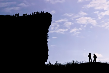 People on the peak of mountain in the morning at the northen of Thailand Stock Photo - 7510372