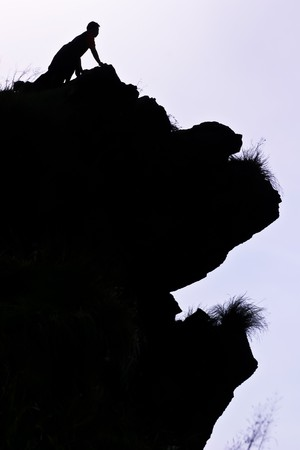 man on the peak of mountain in the morning at the northen of Thailand Stock Photo - 7510370