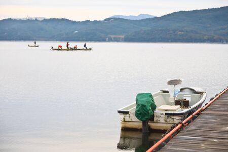 boat on lake near Fuji mountain, Japan photo