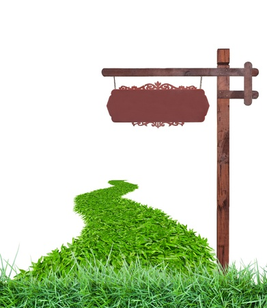 Wooden sign with grass photo