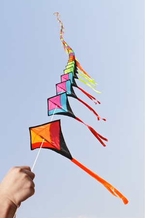 Colorful kites on blue sky photo