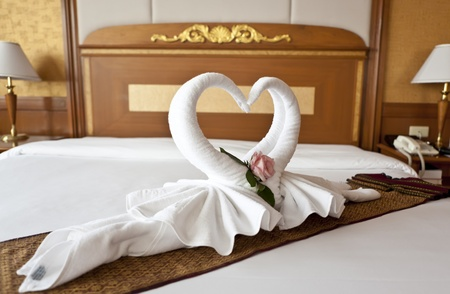 honeymoon suite: Honeymoon Bed Suite decorated with flowers and towels Stock Photo