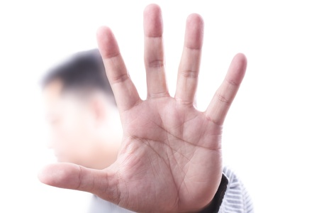 Abstract to stop sign with men hand photo