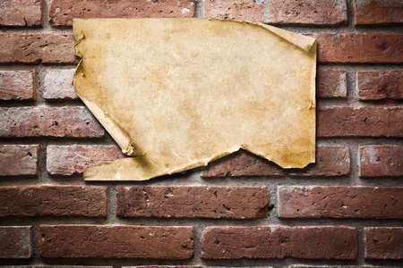 Vintage Paper on brick wall Stock Photo - 8871578