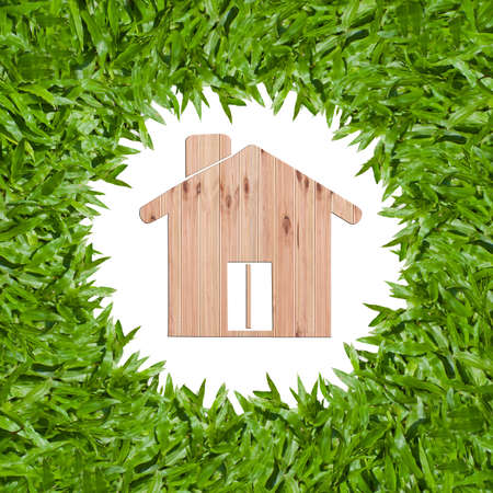 isolated green grass with wooden house photo