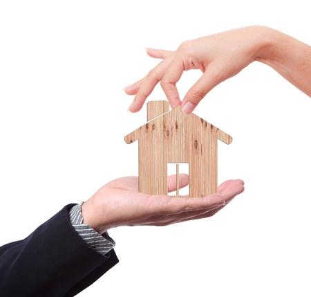 Hands make heart shape with wood house photo