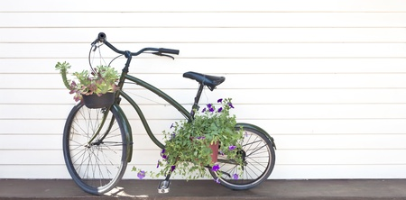 old black bicycle with flowers photo