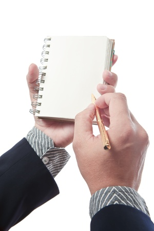 Business man writing on book photo