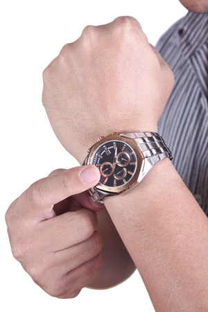 checking: Businessman�s hand with watch on it while he checking the time
