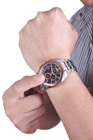 puntualidad: Businessman?s mano con reloj en ella mientras que el tiempo de comprobaci�n Foto de archivo
