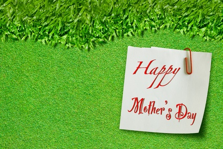 Happy mothers day on green grass  photo