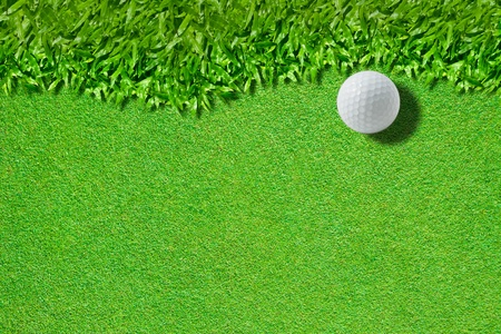 country club: White golf ball on green ( real green grass  background) Stock Photo