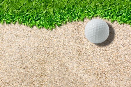 White golf ball on green ( real green grass  background) photo