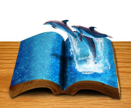 story book: Magic book with three dolphins jump from book page Stock Photo