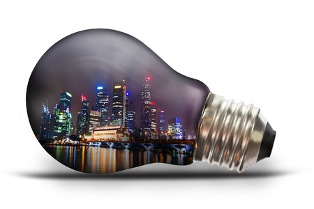 light bulb with city scape at night photo