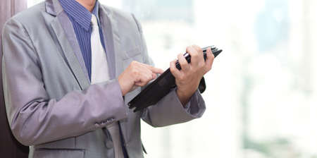 young business man touching tablet pc , New Technology Stock Photo - 9733634